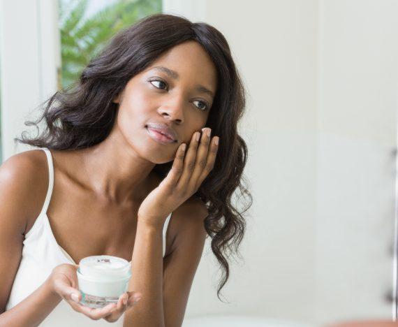 Young woman applying moisturizer | Life As Marita