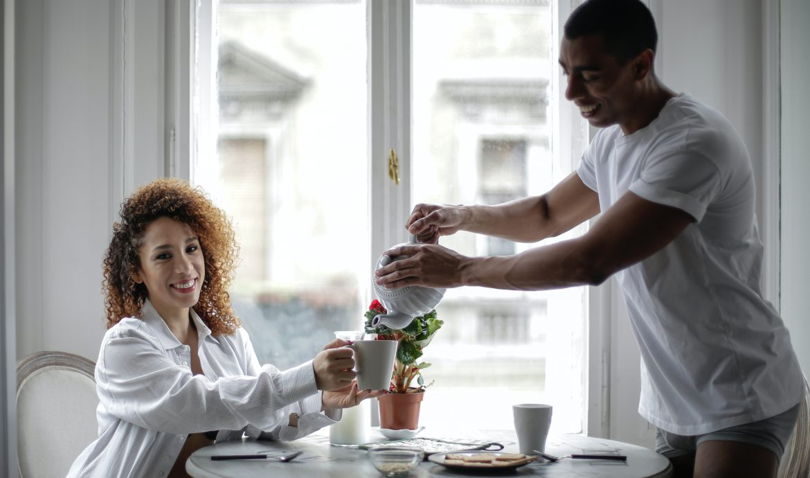 Man pouring tea for his girlfriend